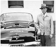 "3) Vincent next to his 1953 Studebaker. ""Drive Carefully"" and ""Insure with Beck, printed on the trunk."