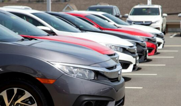 Line of Cars with Car Insurance in Toledo, OH